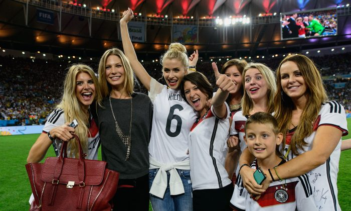 (L-R) Lisa Rossenbach, Sarah Brandner, Lena Gercke, Kathrin Glich, Lisa Wesseler and Sylwia Klose celebrate after Germany defeat Argentina 1-0 in extra time during the 2014 FIFA World Cup Brazil Final match between Germany and Argentina at Maracana on July 13, 2014 in Rio de Janeiro, Brazil. (Matthias Hangst/Getty Images)