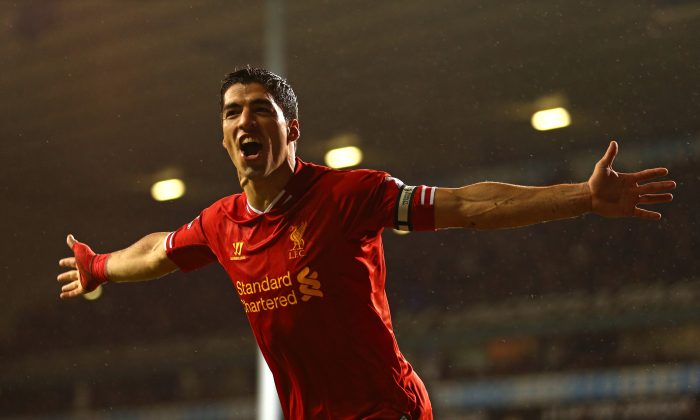 Luis Suarez of Liverpool celebrates scoring their fourth goal during the Barclays Premier League match between Tottenham Hotspur and Liverpool at White Hart Lane on December 15, 2013 in London, England. (Paul Gilham/Getty Images)