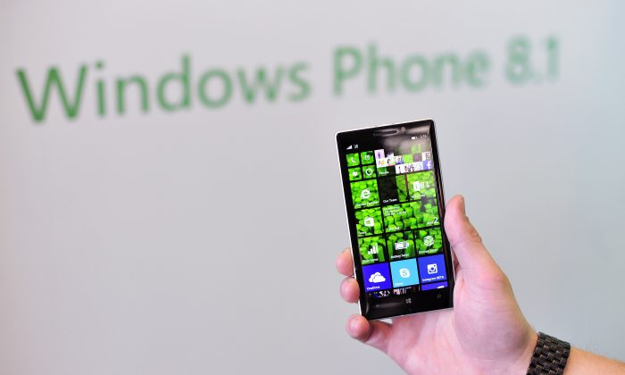 A Nokia employee displays a new Nokia Lumia 930 at More Lumia, a media event in San Francisco, California on Wednesday, April 2, 2014. Nokia announced the release of multiple smart phones and accessories. (Josh Edelson/AFP/Getty Images)