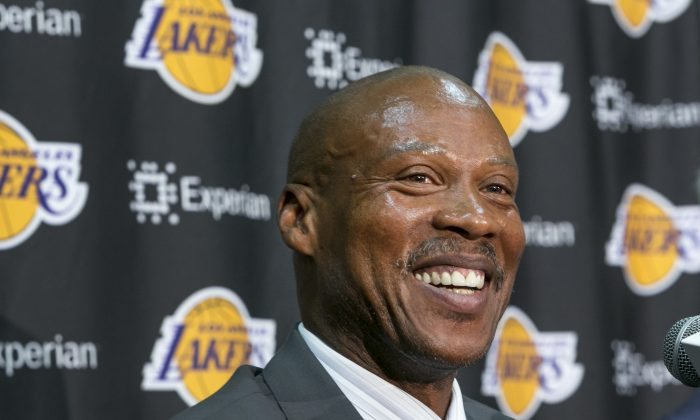 Byron Scott smiles as he is introduced as the successor to Mike D'Antoni as the Lakers' head coach, in a multi-year contract during a news conference in Los Angeles Tuesday, July 29, 2014.  Scott is the former head coach for New Jersey, New Orleans and Cleveland, reaching two NBA Finals with the Nets. He was the NBA's coach of the year in 2008. (AP Photo/Damian Dovarganes)