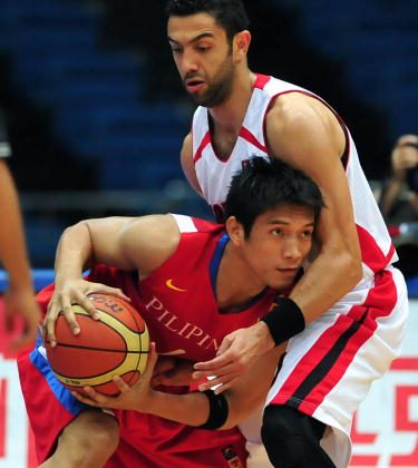 James Carlos Yap of the Philippines (L) looks to pass under pressure from Osama Daghles (R) of Jordan during their quarter final match in the Asian Basketball Championships in Tianjin, northern China, on August 14, 2009. Jordan leads Philippines 45-33 at the first half. AFP PHOTO/Frederic J. BROWN (Photo credit should read FREDERIC J. BROWN/AFP/Getty Images)