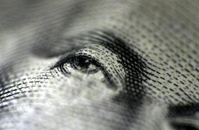 In the eye of the beholders, dollar dominance rules. (Flickr/peasap, CC BY)