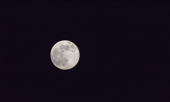 The super moon is seen in the night sky over Tel Aviv, Israel, Sunday, June 23, 2013. (AP Photo/Ariel Schalit)