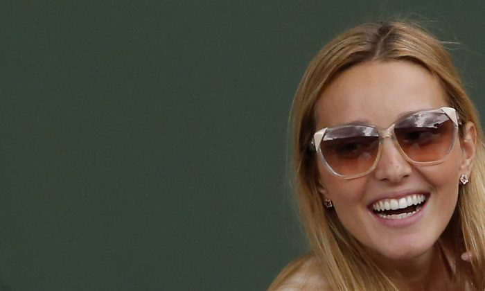 Jelena Ristic, girlfriend of Serbia's Novak Djokovic, smiles as she watches Djokovic during the quarterfinal match of the French Open tennis tournament against Canada's Milos Raonic at the Roland Garros stadium, in Paris, France, Tuesday, June 3, 2014. Djokovic won in three sets 7-5, 7-6, 6-4. (AP Photo/Michel Euler)