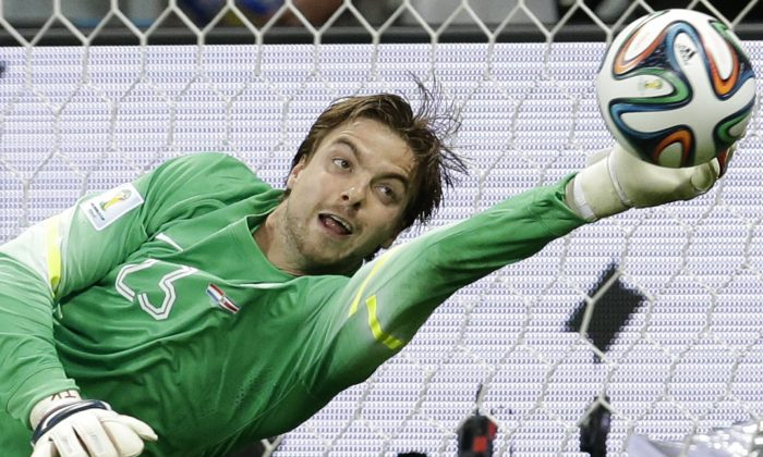 Netherlands' goalkeeper Tim Krul saves the last penalty kick during the World Cup quarterfinal soccer match between the Netherlands and Costa Rica at the Arena Fonte Nova in Salvador, Brazil, Saturday, July 5, 2014. The Ntherlands won 4-3 on penalty kicks. Late substitute Krul made two saves in a 4-3 penalty shootout victory over Costa Rica on Saturday to give the Netherlands a spot in the World Cup semifinals following a 0-0 draw.(AP Photo/Hassan Ammar)