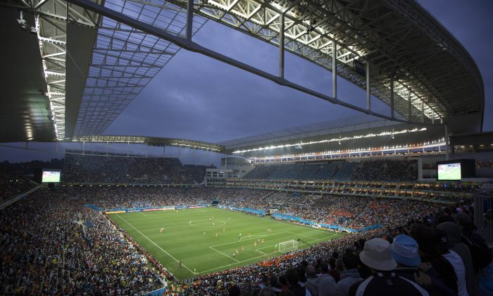 Soccer fans watch the World Cup semifinal match between the Netherlands and Argentina in the Itaquerao Stadium, in Sao Paulo Brazil, Wednesday, July 9, 2014. (AP Photo/Felipe Dana)