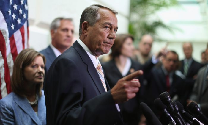 Speaker of the House John Boehner (R-Ohio) talks with reporters after the weekly House Republican caucus meeting at the U.S. Capitol on July 9, 2014. (Chip Somodevilla/Getty Images)
