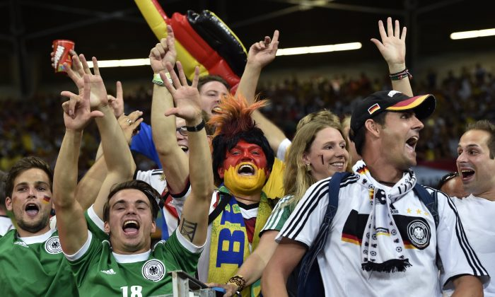 German supporters celebrate after the World Cup semifinal soccer match between Brazil and Germany at the Mineirao Stadium in Belo Horizonte, Brazil, Tuesday, July 8, 2014. Germany won the match 7-1. (AP Photo/Martin Meissner)