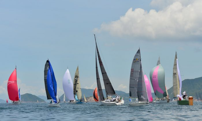 Boats arriving at the Bluff Island Mark during Day-3 of the Quest Yachting Typhoon Series at Hebe haven on Sunday July 6, 2014. (Bill Cox/Epoch Times)