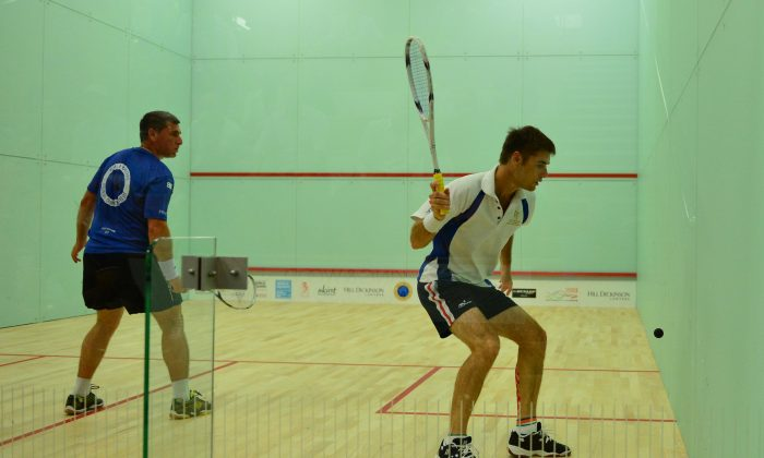 Glen Hitch of Australia on his way to winning his 3rd round match against Daniel Bandiera of France in the 40+ Division of the World Squash Masters Championship, at the Hong Kong Football Club on Monday July 7, 2014. (Bill Cox/Epoch Times)