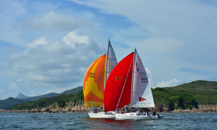 """Jazz"" and ""Windseeker"" head downwind from Bluff Island to the Bay Island Mark during ""The Short Course Dash"" on Day-3 of the Hebe Haven Summer Saturday Series on Saturday July 12, 2014. (Bill Cox/Epoch Times)"