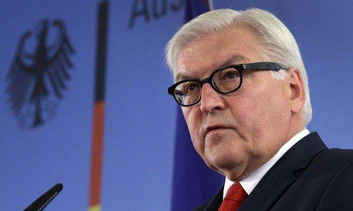German Foreign Minister Frank-Walter Steinmeier address the media during a statement at the Foreign Ministry in Berlin, Germany, Friday, July 11, 2014. (AP Photo/Michael Sohn)