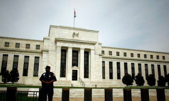 A Federal Reserve Law Enforcement officer stands outside the Federal Reserve in Washington. (Chip Somodevilla/Getty Images)