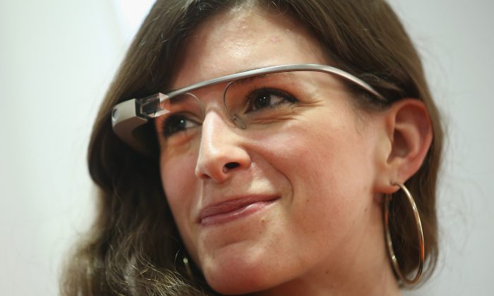 A young woman wears Google Glass at a media event on June 10, 2014 in Berlin, Germany. (Sean Gallup/Getty Images)