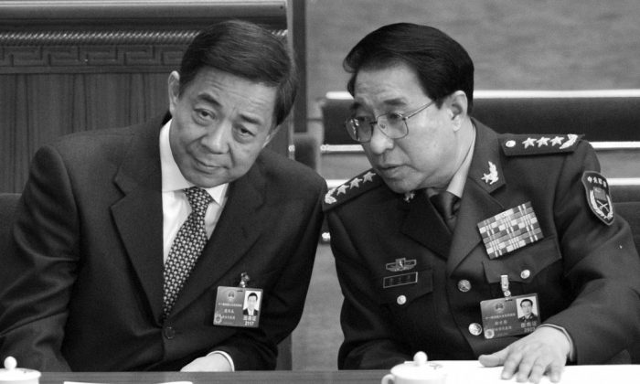 Purged PLA general and Politburo member Xu Caihou's rise to power was pushed along by former president Jiang Zemin, says Chinese media Caixin. In this photo disgraced Politburo member Bo Xilai (L) talks to Xu Caihou at the National People's Congress on March 5, 2012. A little over a month later, Bo Xilai was purged; on July 2, 2014, Xu was also expelled fro the Chinese Communist Party. (Liu Jin/AFP/Getty Images)