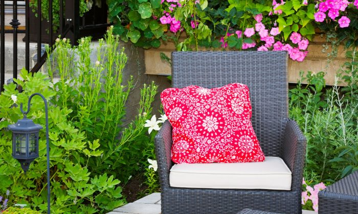 Plants placed in raised wooden beds, behind walls, or separate from walkways and patios are easier to manage. (Brenda Carson/Hemera/Thinkstock)
