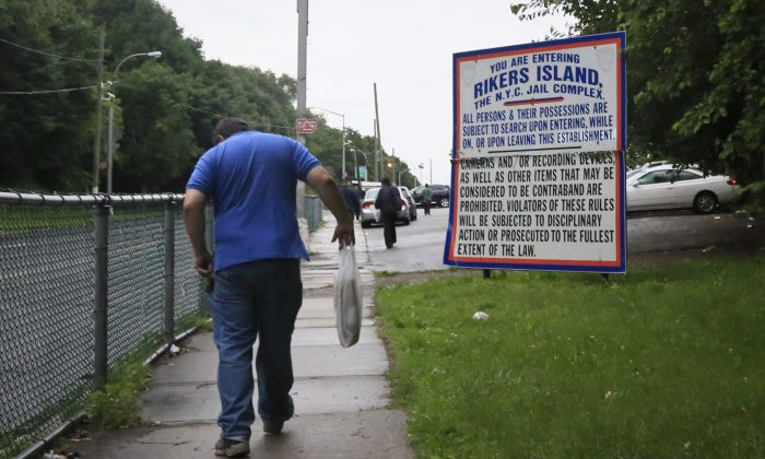 A sign informing visitors what can be brought to Rikers Island jail in the Queens borough of New York, June 11, 2014. City lawmakers will call a special meeting to hear from correction officials how they plan to quell rising levels of violence in city jails, and their plan to effectively treat a growing mentally ill inmate population. (AP Photo/Bebeto Matthews)