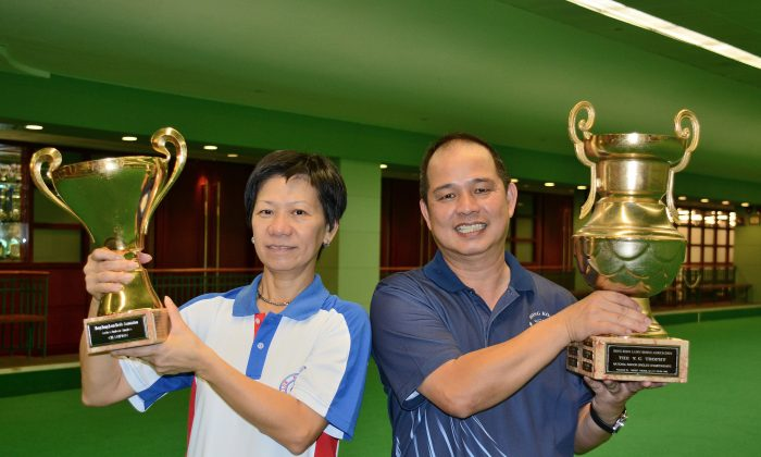 NEW FACES – Celena Kwok (left) and Stephen Chan proudly became the two new winners at the National Indoor Singles after prevailing in the finals held last weekend at The Hong Kong Football Club on Saturday Jul 12, 2014. (Stephanie Worth)
