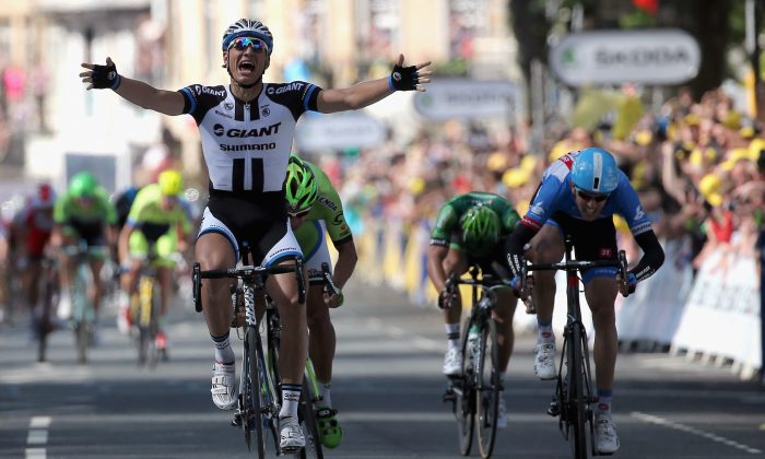 Marcel Kittel of Giant-Shimano celebrates his victory ahead of Peter Sagan of Cannondale in second place, Ramunas Navardauskas of Garmin-Sharp in third place and Bryan Coquard of Europcar in fourth place in Stage One of the 2014 Tour de France from Leeds to Harrogate on July 5, 2014 in Harrogate, United Kingdom. (Doug Pensinger/Getty Images)