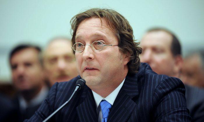 Senior Managing Partner of Harbinger Capital Partners Philip Falcone testifies on Capitol Hill on Nov. 13, 2008. (Kevin Wolf/AP)