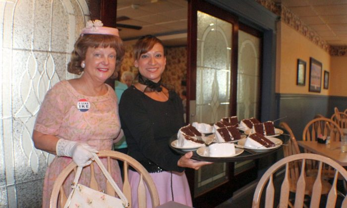 Ruthmary McIlhenny as Mamie Eisenhower with Dunlap Restaurant server Stacy Chavira with tray of Mamie's recipe chocolate cake. (Myriam Moran copyright 2014)