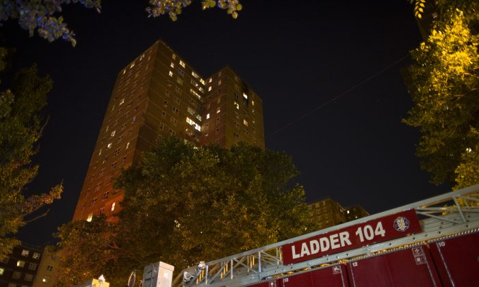 A fire truck at the scene of a fire at public-housing high-rise early Sunday, July 6, 2014, in Brooklyn, New York. (John Minchillo/AP)