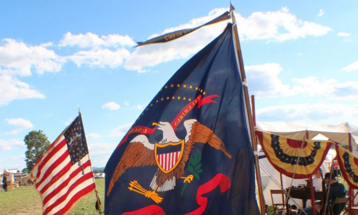 Flags and banners blow in the wind as drum rolls and bugle calls bring reenactors to the field at Gettysnburg, Pennsylvania for the 151st Anniversary of the Civil War battle fought here. (Myriam Moran copyright 2014)