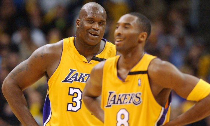 The Lakers had one of the all-time great offseasons in 1996 when they drafted Kobe Bryant (R) and signed Shaquille O'Neal, seen here on Nov. 22, 2002. (Lucy Nicholson/AFP/Getty Images)