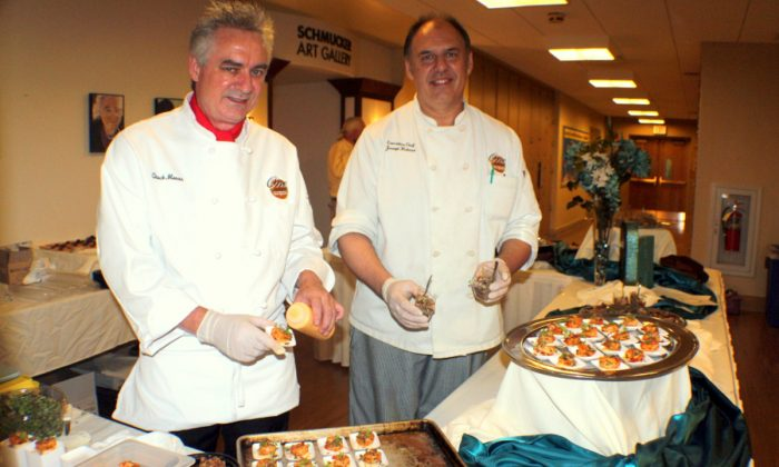 Chuck Moran (Left red collar), General Manager of One Lincoln Square and the Gettysburg Hotel with Chef Joseph Hughes at the Schmukler Gallery preparing amazing treats for guests at the art festival. (Myriam Moran copyright 2014)
