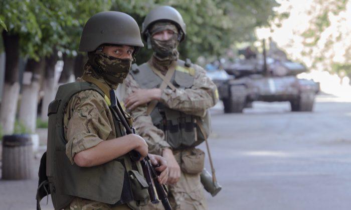 Ukrainian government army's soldiers patrol the city of Slovyansk, Donetsk Region, eastern Ukraine on July 5, 2014. (AP Photo/Dmitry Lovetsky)