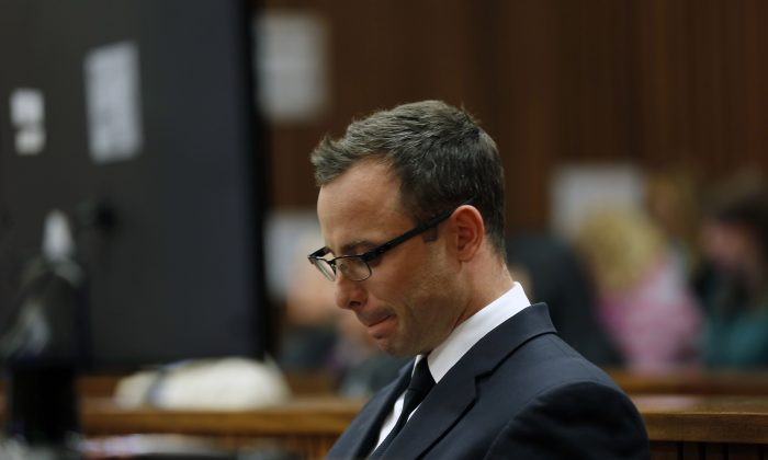 Oscar Pistorius sits in the courtroom during day 37 of his trial in Pretoria, South Africa, Thursday, July 3, 2014. (AP Photo/Jerome Delay, Pool)