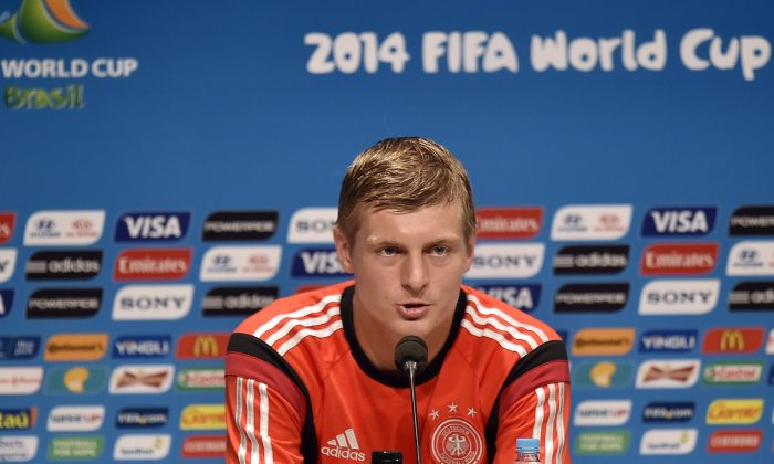 Germany's Toni Kroos talks to the media during a press conference one day before the World Cup quarterfinal soccer match between Germany and France at the Maracana Stadium in Rio de Janeiro, Brazil, Thursday, July 3, 2014. (AP Photo/Martin Meissner)