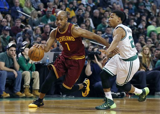 In this Dec. 28, 2013 file photo, Cleveland Cavaliers' Jarrett Jack (1) drives past Boston Celtics' Phil Pressey (26) in the second quarter of an NBA basketball game in Boston. A person familiar with the deals says the Cavaliers have agreed to trade Jack, swingman Sergey Karasev and center Tyler Zeller, moves that can help their pursuit of LeBron James by clearing salary cap space. (AP Photo/Michael Dwyer, File)