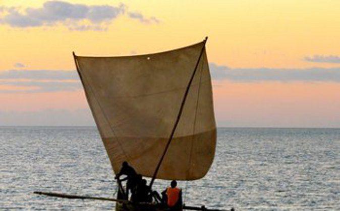An outrigger canoe off the coast of Madagascar. photos by Jean M. Spoljaric. (Go Nomad)