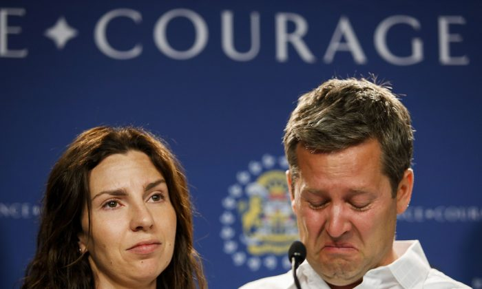Rod and Jennifer O'Brien show their emotions as they speak to the media about their son Nathan O'Brien and his grandparents Alvin and Kathryn Liknes during a press conference in Calgary on July 2, 2014. (The Canadian Press/Jeff McIntosh)