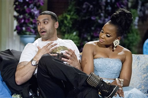 "This 2014 image released by Bravo shows Apollo Nida, left, and his wife Phaedra Parks, cast members on ""The Real Housewives of Atlanta,"" during the taping of a reunion special in Atlanta. (AP Photo/Bravo, Wilford Harewood)"
