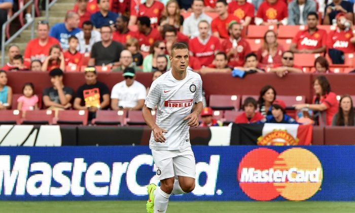 Inter Milan's Nemanja Vidic moves the ball during a Champions Cup match against Manchester United at FedEx Field in Landover, Maryland, on July 29, 2014. (NICHOLAS KAMM/AFP/Getty Images)