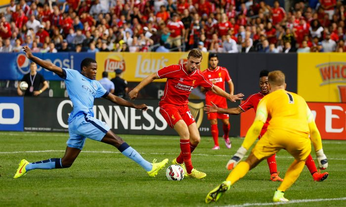 Joe Hart #1 of Manchester City defends the net against Jordan Henderson #14 of Liverpool during the International Champions Cup 2014 at Yankee Stadium on July 30, 2014 in the Bronx borough of New York City. (Photo by Mike Stobe/Getty Images)