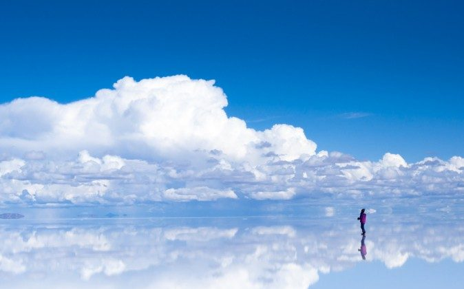 At the Salar de Uyuni salt plane in Bolivia, still and shallow water often reflects the mountains with startling clarity. This region's mystique goes beyond this natural phenomenon, however—author Jim Allen says this area may be home to the fabled Atlantis. (Shutterstock*)