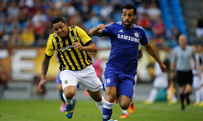 Mohamed Salah of Chelsea and Wallace Oliveira dos Santos of Vitesse battle for the ball during the pre season friendly match between Vitesse Arnhem and Chelsea at the Gelredome Stadium on July 30, 2014 in Arnhem, Netherlands. (Photo by Dean Mouhtaropoulos/Getty Images)