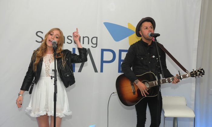 NEW YORK, NY - JULY 31:  Danielle Bouchard and Mitchy Collins of OH, Honey perform at Samsung Shape Summer Mix Series With Oh Honey on July 31, 2014 in New York City.  (Photo by Brad Barket/Getty Images for Samsung)
