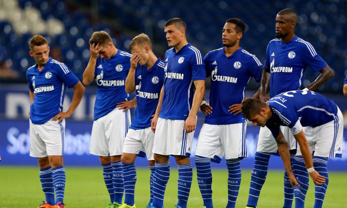 The team of Schalke looks dejected after losing the penalty shoot-out of the match between FC Schalke 04 and West Ham United as part of the Schalke 04 Cup Day at Veltins-Arena on August 2, 2014 in Gelsenkirchen, Germany. The match between Schalke and West Ham United ended 6-7 after penalty shoot-out. (Photo by Christof Koepsel/Bongarts/Getty Images)