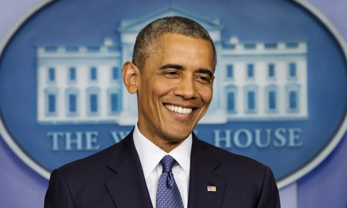 This Aug. 1, 2014, photo shows President Barack Obama as he smiles near the conclusion of a news conference in the Brady Press Briefing Room of the White House in Washington, Friday, Aug. 1, 2014. President Barack Obama is starting his birthday weekend with a round of golf before escaping to the Maryland mountains. Obama turns 53 on Monday. In what's become an annual birthday tradition, he's joining friends on the green for an early morning round at Andrews Air Force Base in suburban Maryland. He'll board Marine One later Saturday for the short helicopter flight to Camp David, the presidential retreat in the Catoctin Mountains. (AP Photo/Jacquelyn Martin)