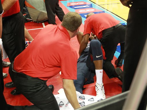 Indiana Pacers' Paul George is attended to after injuring his right leg during the USA Basketball Showcase on Friday, Aug. 1, 2014, in Las Vegas. (AP Photo/Las Vegas Sun, Sam Morris)