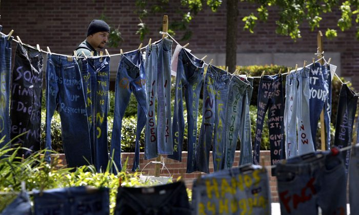 A man looks at blue jeans with messages challenging misconceptions about sexual violence, hung by the UCLA Clothesline Project, on the University of California Los Angeles campus during Denim Day in Los Angeles, Calif., on April 21, 2004 The UCLA Clothesline Project is a student organization which works to stop gender-based violence. In 1999, wearing jeans on Denim Day during Sexual Assault Awareness Month became an international symbol of protest against rape in response to an Italian Supreme Court decision, which overturned a rape conviction because the victim wore jeans. The Italian Court justices reasoned that the victim must have helped her attacker remove her jeans because they believed that without the victim's help, removing the jeans would be impossible. (David McNew/Getty Images)