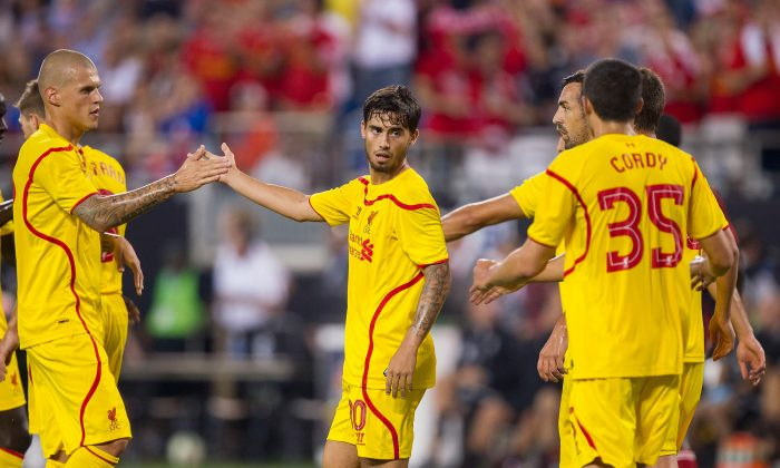 Suso #30 is congratulated by teammates after scoring a goal in the 90th minute against A.C. Milan in the Guinness International Champions Cup at Bank of America Stadium on August 2, 2014 in Charlotte, North Carolina. Liverpool defeated A.C. Milan 2-0. (Photo by Brian A. Westerholt/Getty Images)