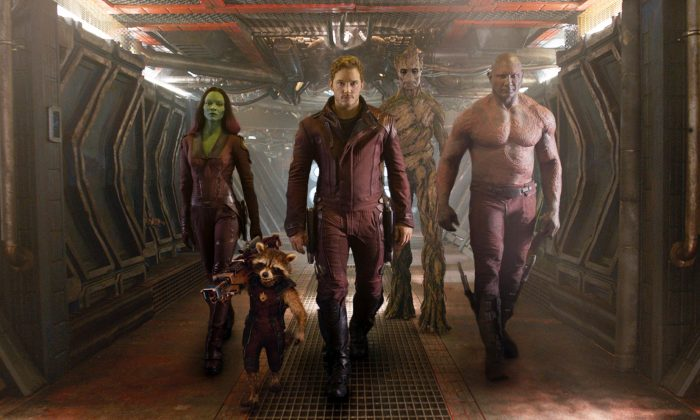 "This image released by Disney-Marvel shows: (L-R) Zoe Saldana, the character Rocket Racoon, voiced by Bradley Cooper, Chris Pratt, the character Groot, voiced by Vin Diesel and Dave Bautista in a scene from ""Guardians of the Galaxy."" The movie releases on Friday, Aug. 1, 2014. (AP Photo/Disney, Marvel)"