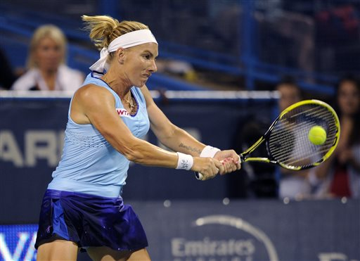 Svetlana Kuznetsova, of Russia, chases the ball against Ekaterina Makarova, of Russia, during a match at the Citi Open tennis tournament, Saturday, Aug. 2, 2014, in Washington. (AP Photo/Nick Wass)
