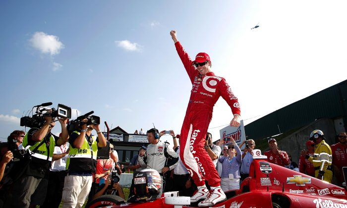 Scott Dixon of New Zealand, driver of the #9 Target Chip Ganassi Racing Dallara Chevrolet, celebrates after winning the Verizon IndyCar Series Honda Indy 200 at Mid-Ohio Sports Car Course on August 3, 2014 in Lexington, Ohio. (Kirk Irwin/Getty Images)