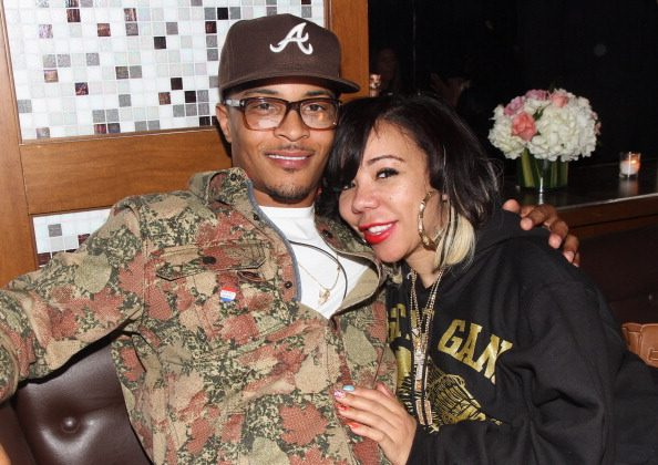 T.I. and Tameka Tiny Cottle-Harris attend Moet Rose Lounge presents T.I., a celebration for his new album Trouble Man: Heavy is The Head at Baoli on November 20, 2012 in Miami, Florida.  (Photo by Aaron Davidson/Getty Images for Moet)